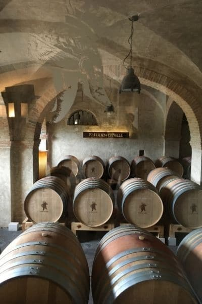 stacked wine barrels in Château Saint Julien d'Aille Provence France