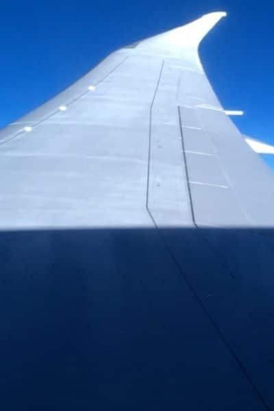 Airplane wing-know airfares to create travel budget
