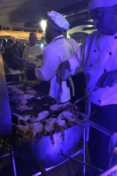Chefs bbqing lobster Buzios Brazil