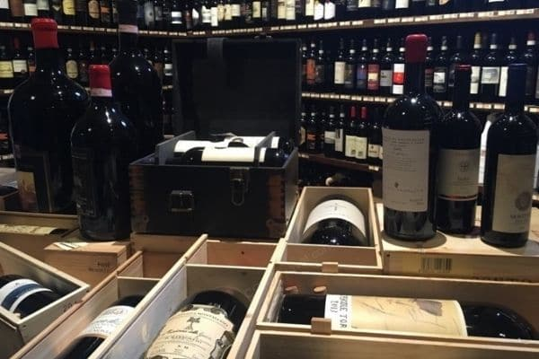 Crates and bottles of wine Montalcino Italy