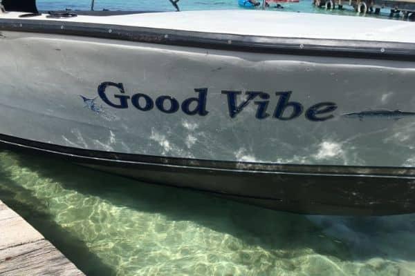 Good Vibe boat in water in Belize