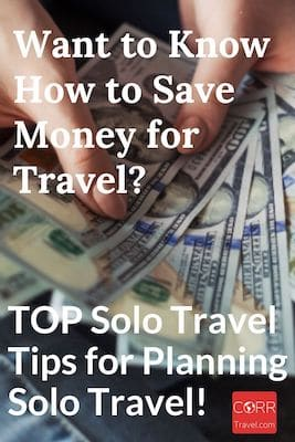 Person counting money-Pinterest2-solo travel tips