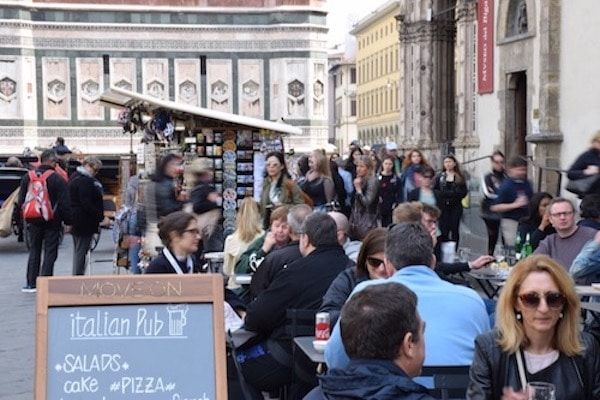 People dining in Piazza del Duomo Florence Italy