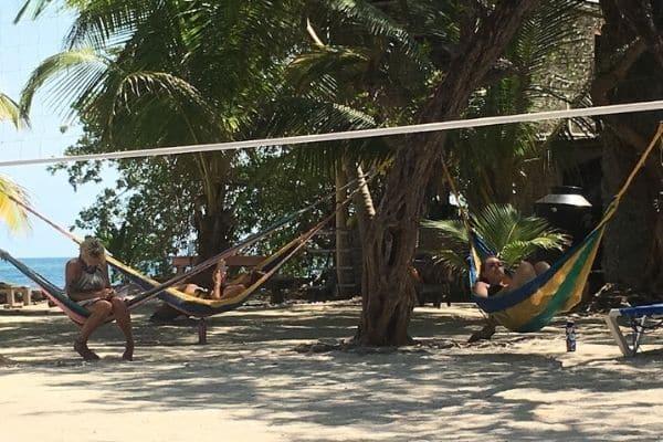 People in hammocks Reef CI Belize