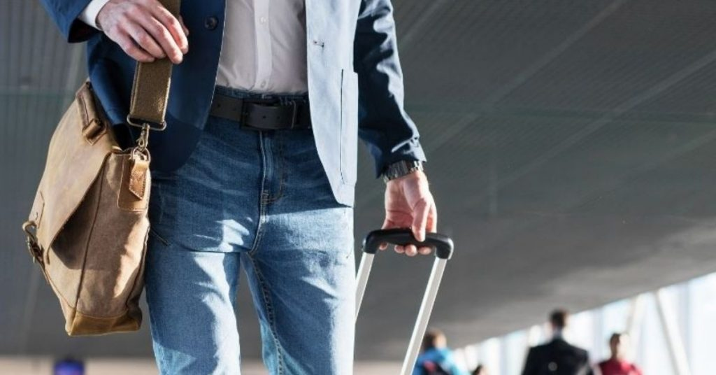Person in airport with hand luggage