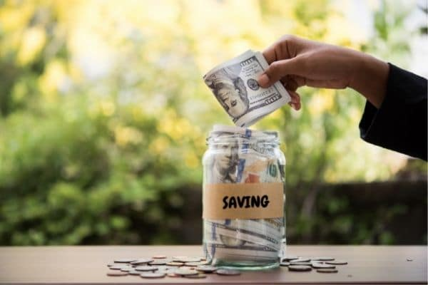 Setting money aside in a jar saves money for travel