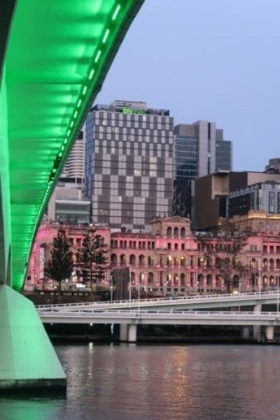 Underneath lit Victoria Bridge Brisbane