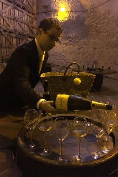 Veuve Clicquot employee pouring champagne