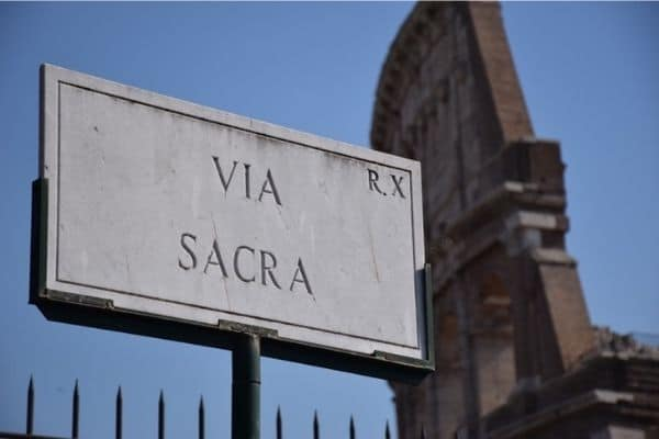 Via Sacra sign and Colosseum Rome Italy