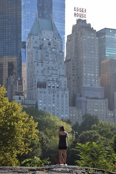 Woman standing with New York City skyline backdrop