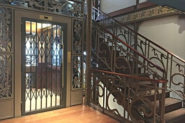 Art Nouveau elevator and staircase Old England Building Brussels