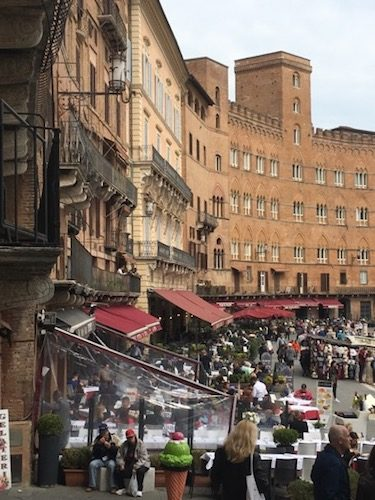 Il Campo Siena Italy cityscape and people