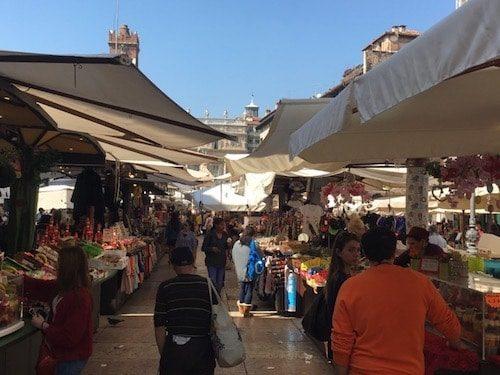 Tourists shopping Verona Italy market