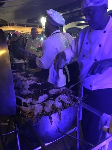 Food vendors cooking shrimp, Buzios Brazil - a solo trip destination