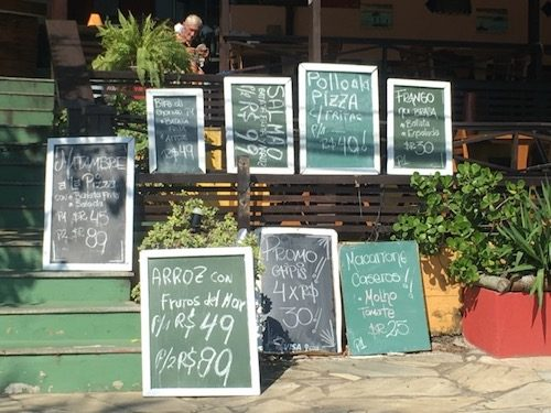 Food signs outside restaurant Buzios Brazil
