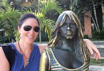 Gwen with statue in Buzios Brazil