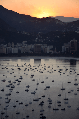 Boats on water at Rio de Janeiro Brazil during sunset