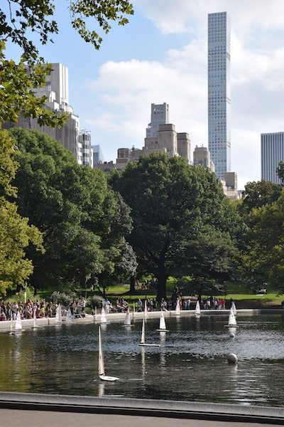 Boats on lake in Central Park with New York City skyline