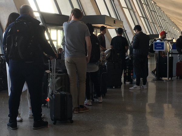 People standing in airport line