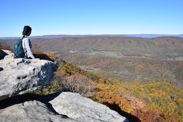 Hiker sitting on overlook traveling alone