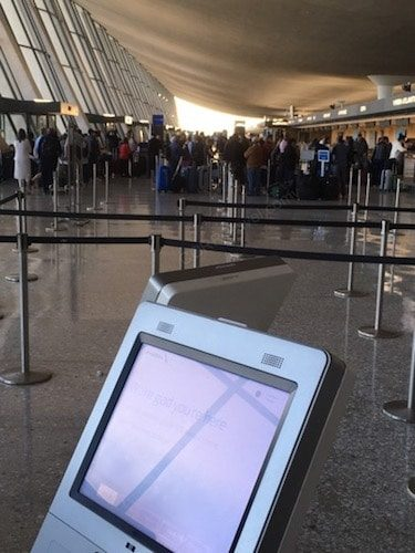 Airport line with ticket kiosk