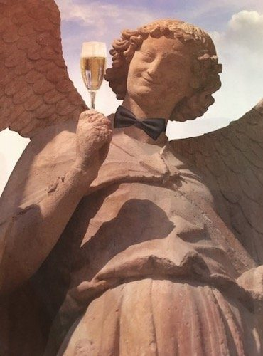 Picture of angel statue holding glass of champagne