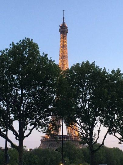 Eiffel Tower Paris lit at dusk