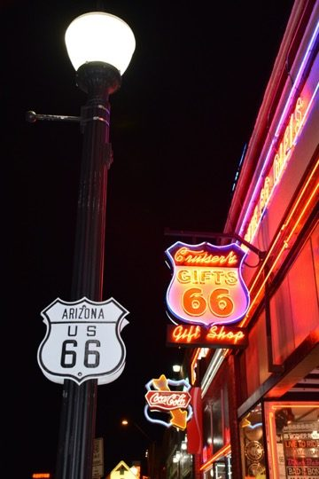 Route 66 signs at night Williams AZ