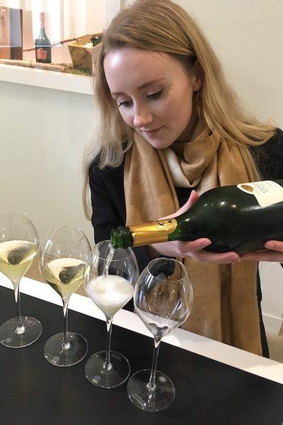 Tattinger employee pouring champagne for tasting