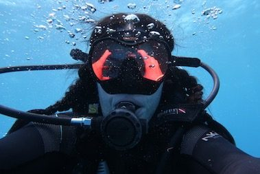 CORR Travel founder selfie underwater diving Belize