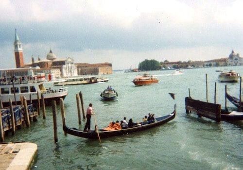 Gondola and vaporettos on the water Venice Italy
