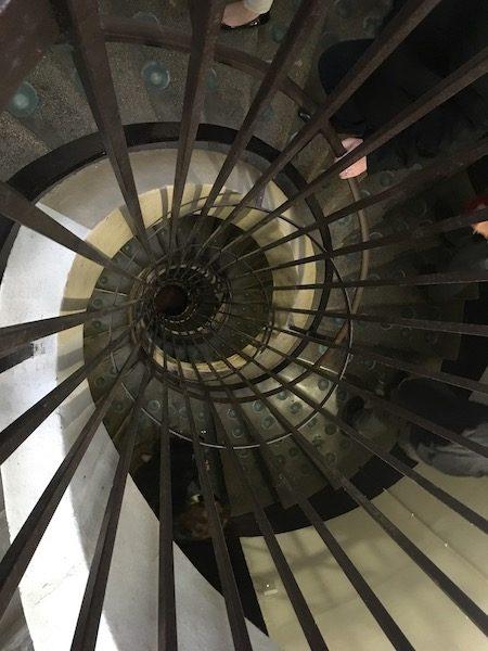 Walking down spiral staircase to Tattinger cavern